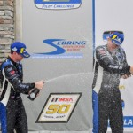 James and Devin with champagne on podium - BimmerWorld Racing Charges to Podium in MICHELIN Pilot Challenge Race at Sebring
