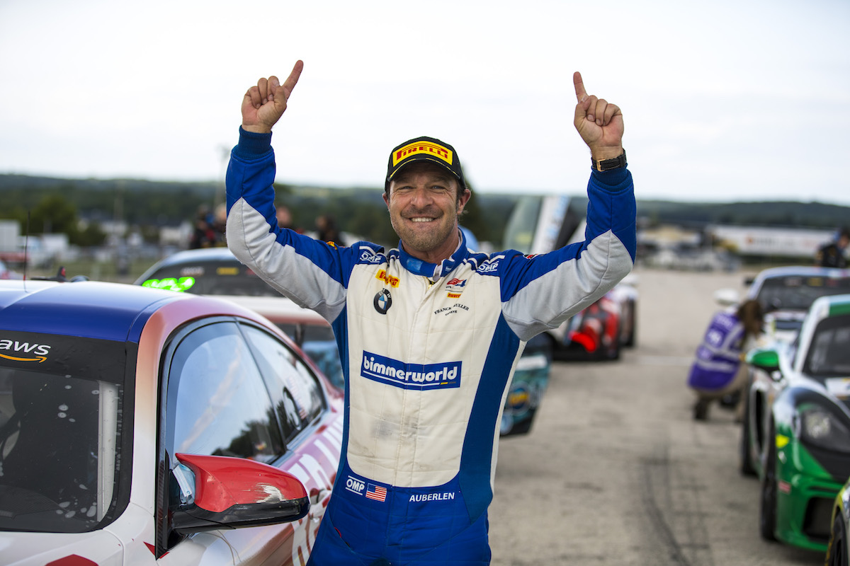 Bill Auberlen celebrating his win with BimmerWorld at Road America