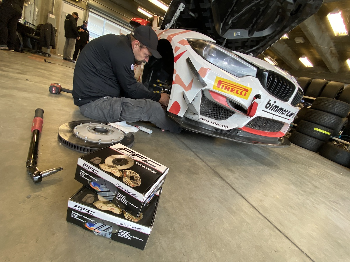 New PFC race pads being installed on the Red Line Oil BMW M4 GT4 at Indy