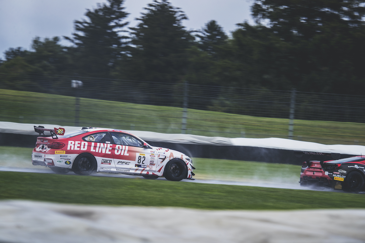 Red Line Oil M4 GT4 racing in the rain at Indy
