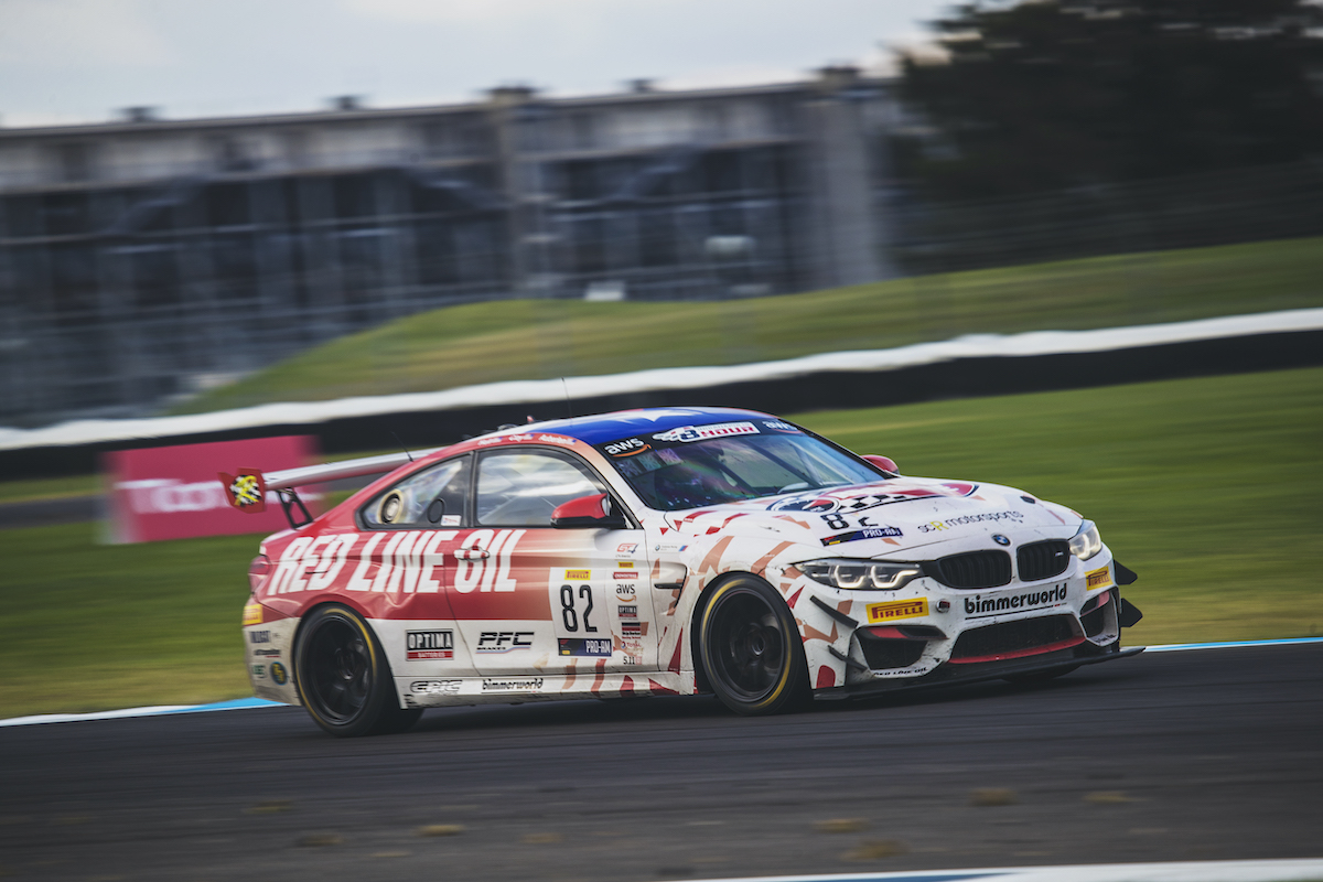 BimmerWorld Red Line Oil M4 GT4 charging hard at Indy