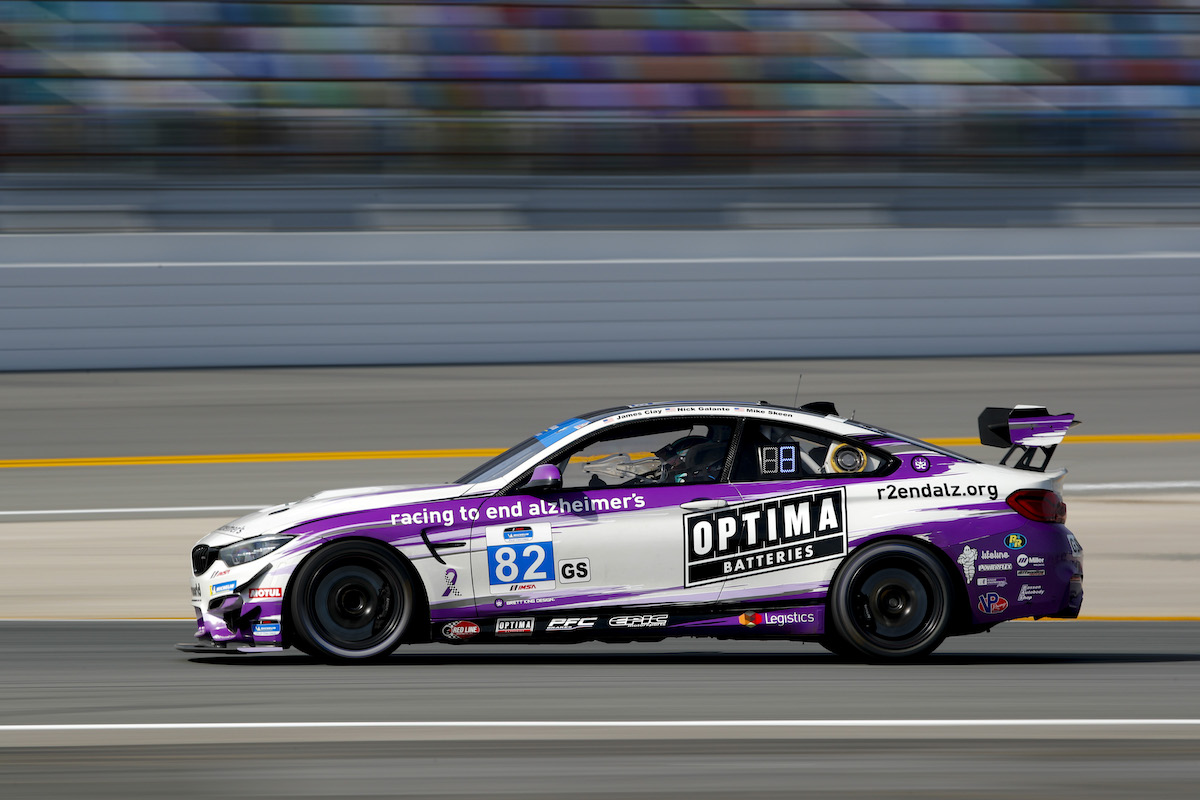 Side profile of BWR M4 GT4 on the infield BimmerWorld Racing - IMSA Michelin Pilot Challenge - Daytona International Speedway