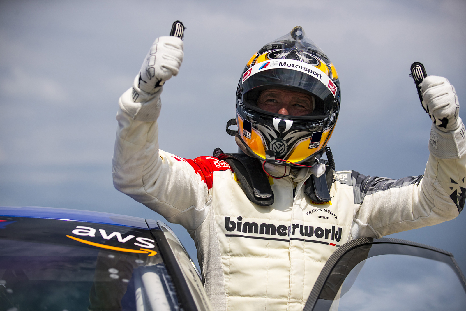 Auberlen getting out of his BimmerWorld M4 GT4 after winning at Road America